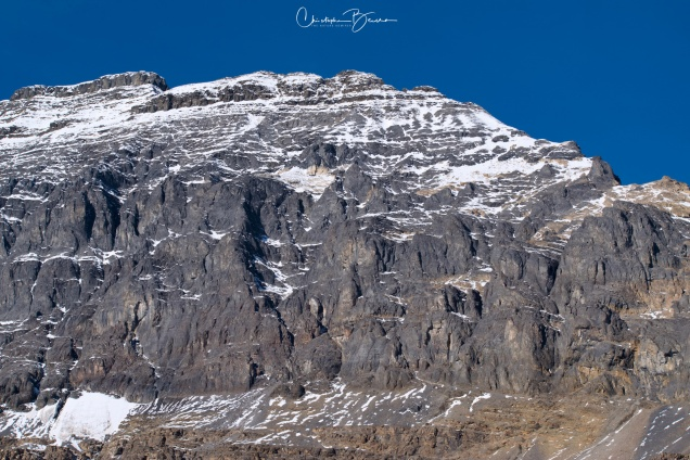 Another peak, with less snow. During spring, most of the ice melts and leaves the bare rock behind.
