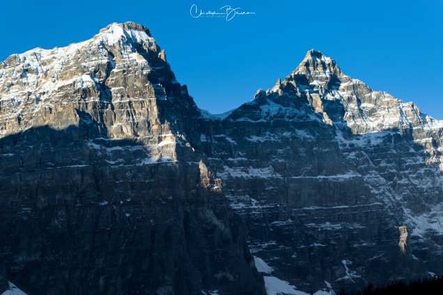 Two of the peaks in Moraine Lake. The right one looks just like a pyramid.
