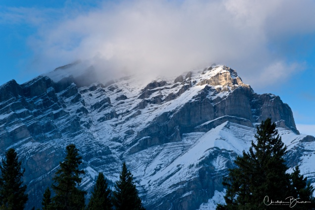 Clouds were trying to cover the peak. In this close up, you can see how the rock edges are sharply carved, product of years upon years of snow and ice.