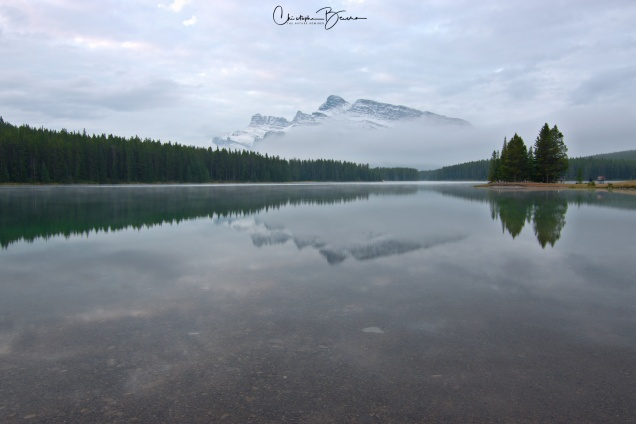 Now that the wind stopped and reflections on the water started to show, the clouds almost obscured completely Mount Rundle.