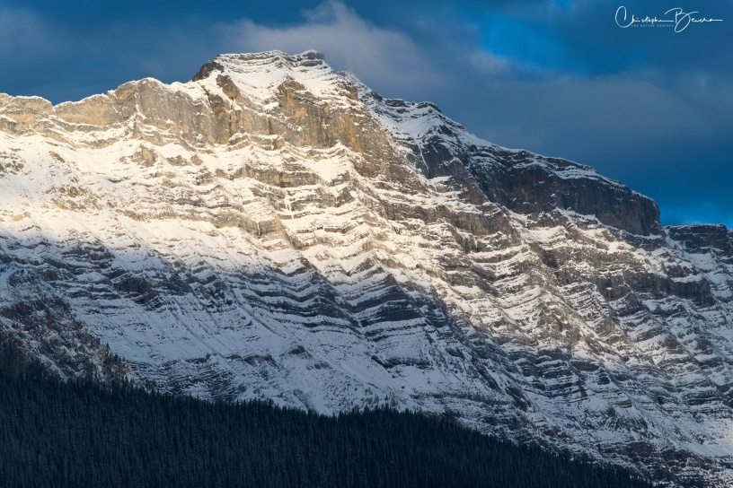 Snow carves the rock and gives rough edges as time passes. Here, the peak is being illuminated by the morning sun.