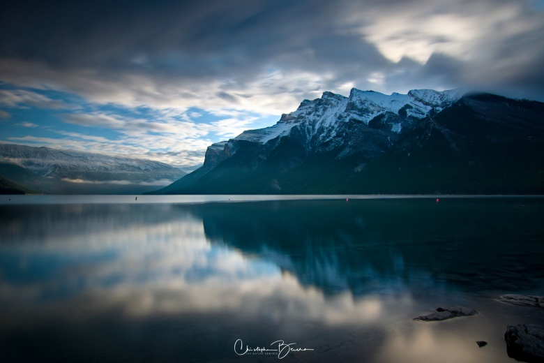 The clouds help to give a dramatic look to this landscape as they reflect onto the water's surface.