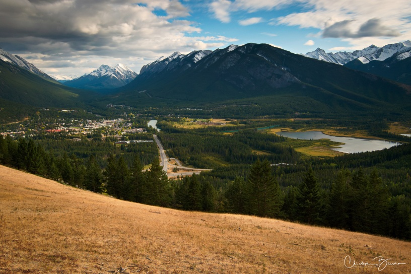Wide angle view of Banff, with Vermillion lakes by the right as well, and featuring Sulphur Mountain in the back.