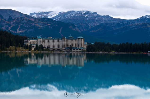 Melancholia aside, this is a view of majestic Fairmont Chateau Lake Louse hotel, with Lake Louise itself in the foreground. In the back, the Lake Louise Ski Resort at Whitehorn Mountain.